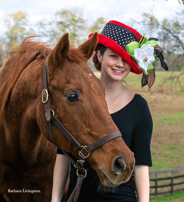"The ""Bint Marscay"" Hat modeled by Shelby Landeros with her husband jockey Chris Landeros - Photo by Barbara D. Livingston"