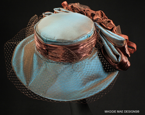 Metallic turquoise taffeta wide brim Derby hat with chocolate roses