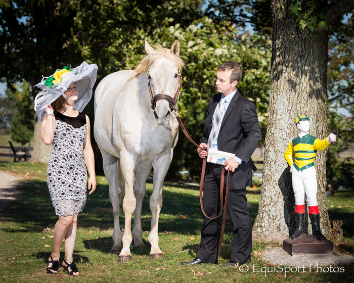 """Silver Charm"" Hat modeled by Rosie Napravnik with Joe and Carson Sharp - Matt/Wendy Wooley, EquisportPhotos.com"